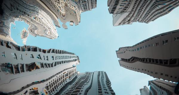 Häuser gespiegelt im Wasser. Foto: Photo by ariel sion on Unsplash.com.